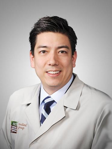 Benjamin VanCura, M.D., NCH Medical Group gastroenterologist, in his lab coat.