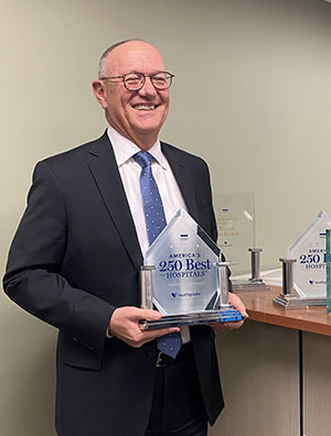 NCH President and CEO Stephen Scogna proudly holds the Healthgrades 2020 America's 250 Best Hospitals Award.