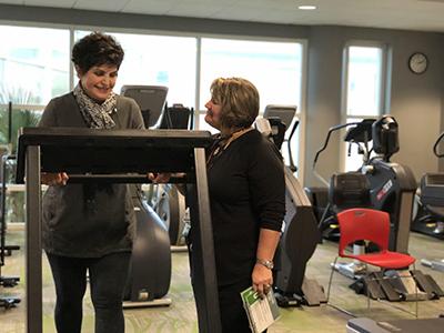 Debbie Gianokopolous, R.N. monitors PAD patient Jan Mirabella, 76, of Lake Barrington during a SET class. Jan is walking to improve circulation in her legs.