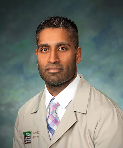 Dr. Abraham in his Medical Group lab coat.