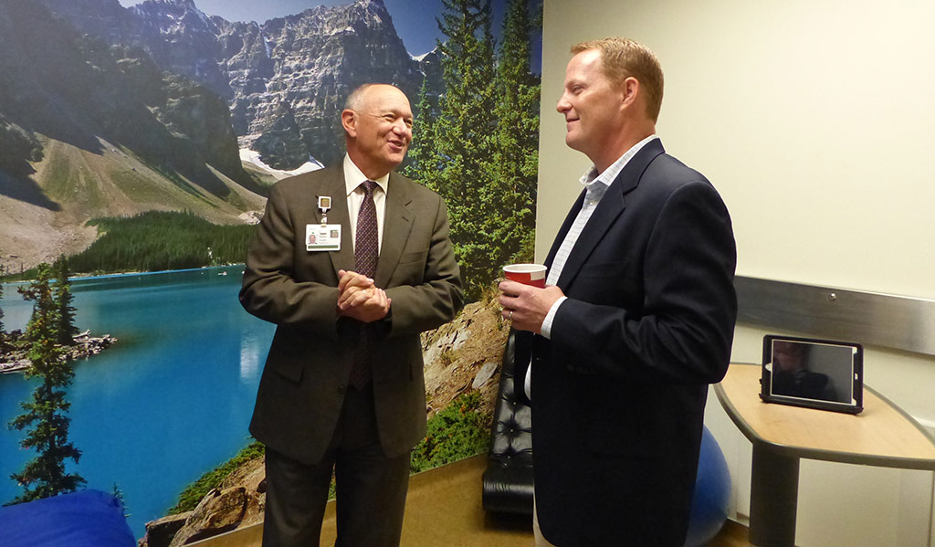 At left, Steve Scogna, President and CEO, talks with donor Chris Dungan in one of two sensory rooms in the Northwest Community Hospital (NCH) Emergency Department.