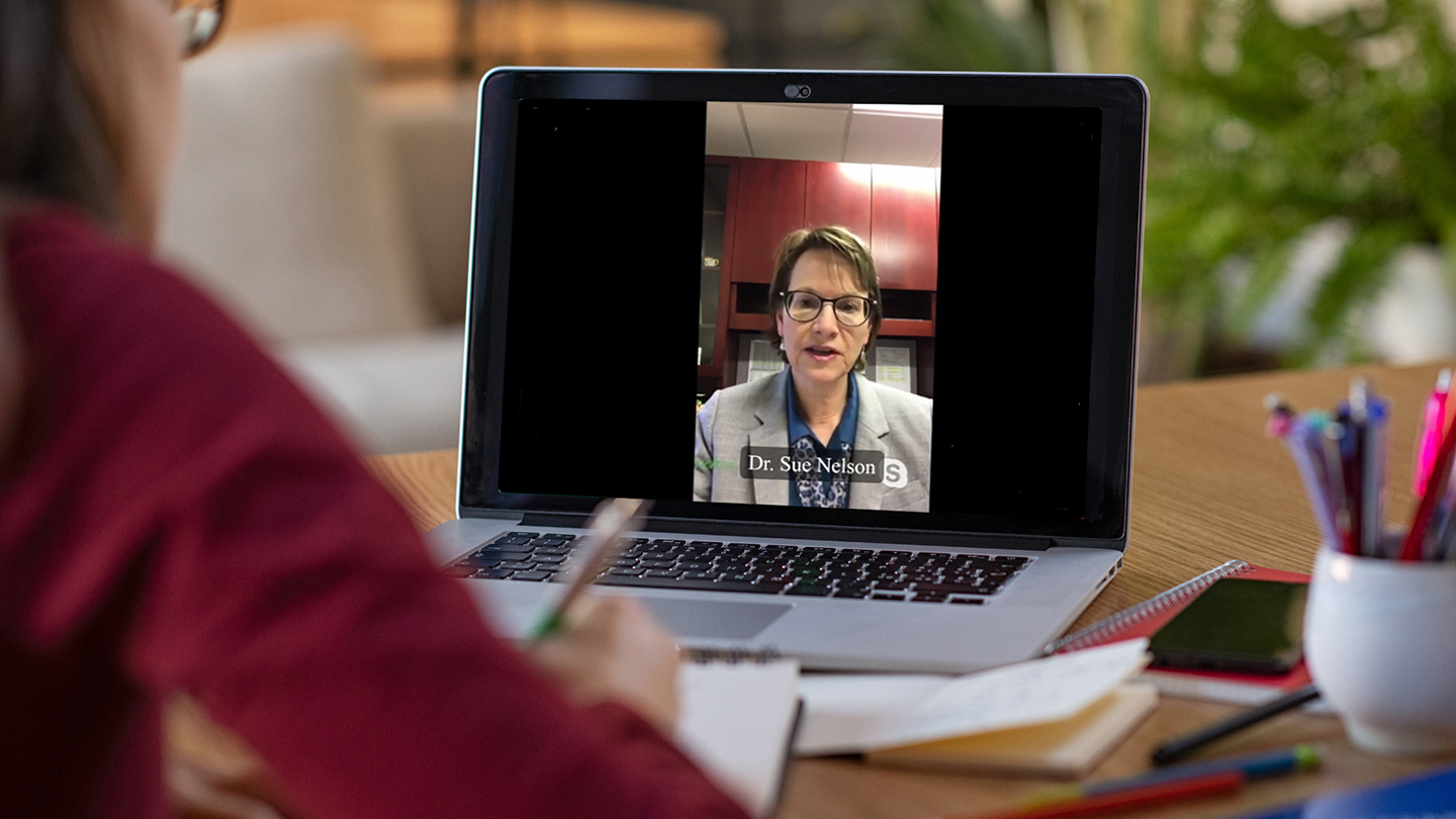 A community member takes notes during a webinar presented by an expert on the COVID-19 vaccine.